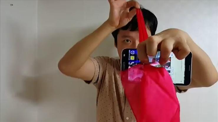 Silk Thru Phone by Jeimin Lee -... MagicWorld Magic Shop